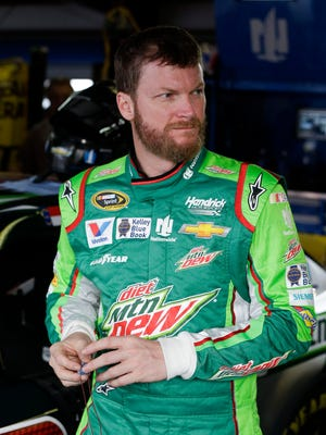 Sprint Cup Series driver Dale Earnhardt Jr. leaves the garage after practicing for Sunday's NASCAR auto race at Talladega Superspeedway, Friday, Oct. 23, 2015, in Talladega, Ala. (AP Photo/John Bazemore)