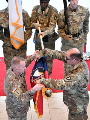 The 101st Airborne Division's color casing ceremony for their nine-month deployment to Afghanistan. Maj. Gen. Andrew Poppas, 101st Airborne Division commander, right,  and Command Sgt. Maj. Todd Sims case the division headquarters' colors, April 3, at McAuliffe Hall on Tuesday April 3, 2018, in Ft Campbell, KY