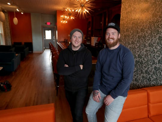 The Lost Whale's owners, bartenders Daniel Beres (left)