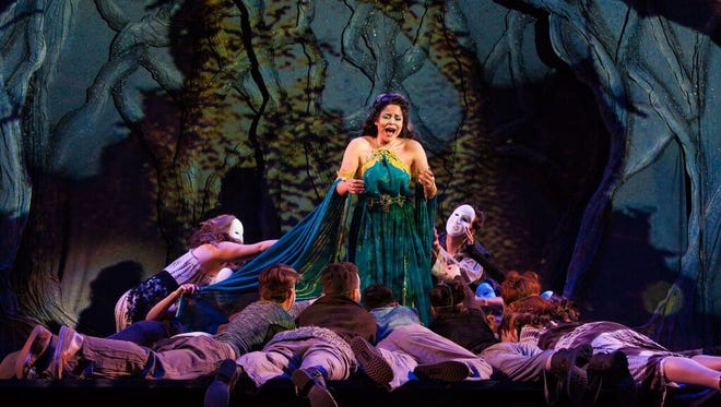 """The title character sings to her bewitched lovers in the Florida State Opera's production of """"Alcina."""""""