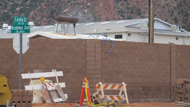 The roofline of the Leroy S. Johnson meetinghouse of the Fundamentalist Church of Jesus Christ of Latter Day Saints is visible behind a 12-foot-high wall in Colorado City in this July 4, 2015 photo.