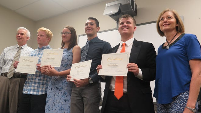 School of Life Foundation co-founders Jack Rolfe, left, and his wife Lexie Rolfe, far right, celebrate Monday with scholarship recipients Jonas Christensen, second from left, Jessica Chatwin, Alec Perez and Nick Dallas.