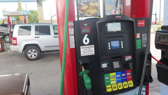 Cars line up at the pump at a gas station in St. George on Wednesday, June 29, 2016.