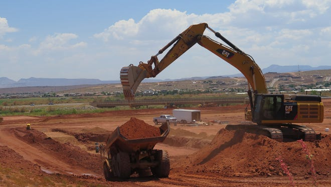 Construction crews perform earth work at a site along the Virgin River near Mall Drive. Two new grocery stores, one already completed, have moved into the area since a new bridge opened in 2014, and the St. George City Council is slated to consider a new request for office space and other businesses nearby during its meeting on Thursday.