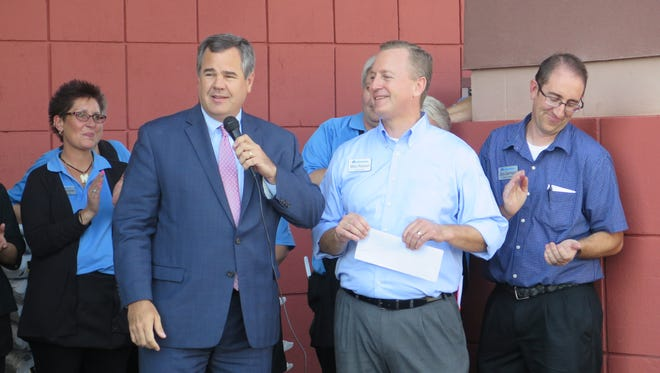 St. George Mayor Jon Pike, left, speaks during a ribbon cutting ceremony at the newly-renovated Dixie Drive Albertsons on Wednesday.
