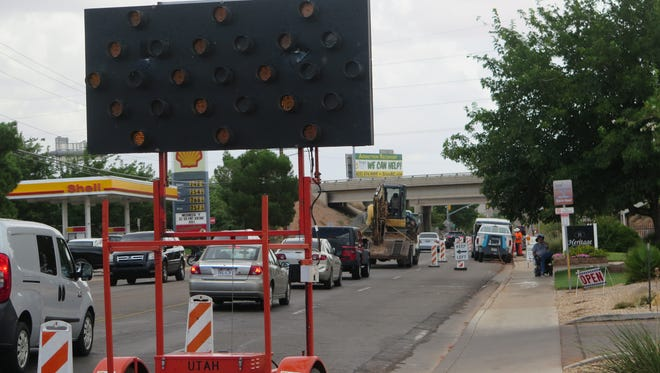 Traffic moves past road work along 700 South in St. George on Wednesday, Aug. 10, 2016