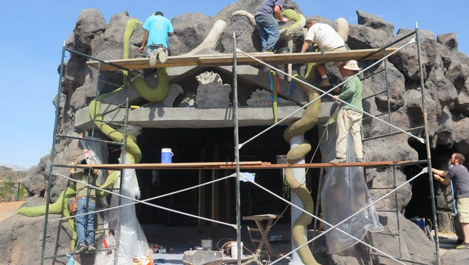 A team of painters and other workers put the finishing touches on a rock feature at the new Thunder Junction park under construction in St. George on Wednesday, Aug. 17, 2016.