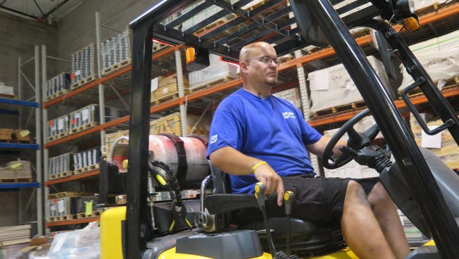 James Aaron Navarro operates a forklift at the St. George warehouse of Carpets Plus, where he's found employment after several years away from the workforce.
