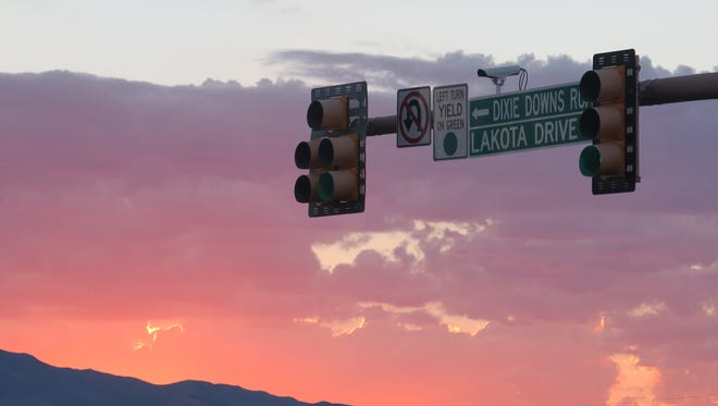 A street sign hangs over the intersection of Dixie Downs Road and Snow Canyon Parkway in St. George. A proposed gas station development in the area has some residents worried about the potential impacts.