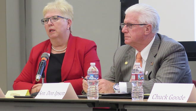 Dorothy Engelman, left, and Utah Sen. Don Ipson, candidates for Senate District 29, debate during a candidate forum Tuesday at Dixie State University.