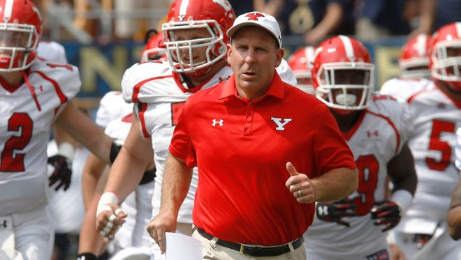 Youngstown State head coach Bo Pelini leads his team on to the field of the NCAA football game against the Pittsburgh, Saturday, Sept. 5, 2015 in Pittsburgh. (AP Photo/Keith Srakocic)