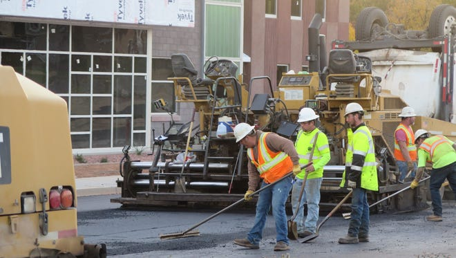 Construction crews complete pavement work in front of the new Legacy Elementary School in St. George on Thursday, Dec. 1, 2016. The school project is one of the dozens of major projects that been undertaken in the city this year.