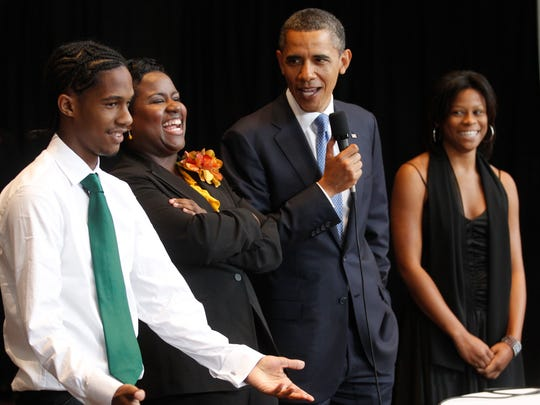 President Barack Obama stands with, from left to right: student Christopher Dean, Principal Alisha Kiner, and student Cassandra Henderson as he speaks to graduates before he delivers the commencement address at the Booker T. Washington High School graduation at Cook Convention Center in Memphis, Tenn., Monday, May 16, 2011. (AP Photo/Charles Dharapak)