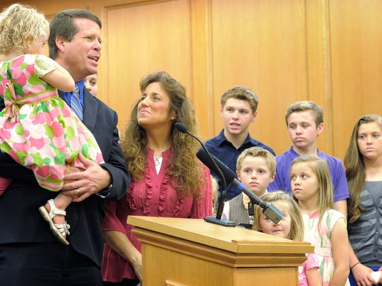 Jim Bob an Michelle Duggar stand with some of their 19 children during a press conference in support of Amendment 1. Monday Sept. 29, 2014, in Nashville, TN.
