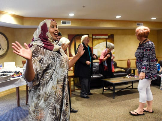 Hudda Ibrahim greets guests at the beginning of a Dine and Dialogue event in 2017 in St. Cloud.