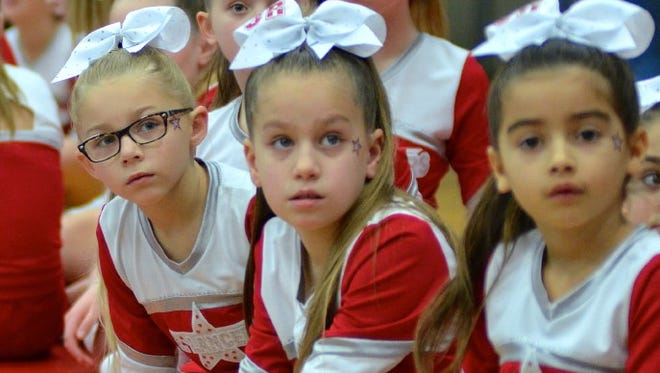 The Junior Lancers standing by, ready to hit the mat in the 15th Annual Cutter Classic Cheer Competition.