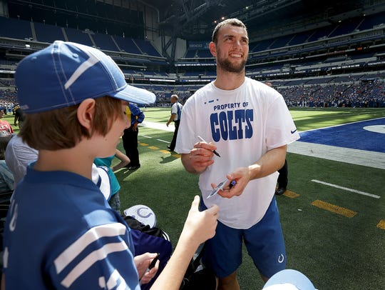 Indianapolis Colts quarterback Andrew Luck signs autographs