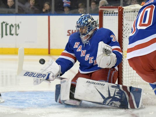 New York Rangers goalie Henrik Lundqvist deflects the puck during the first period of an NHL hockey game against the Detroit Red Wings, Friday, Nov. 24, 2017, at Madison Square Garden in New York. (AP Photo/Bill Kostroun)