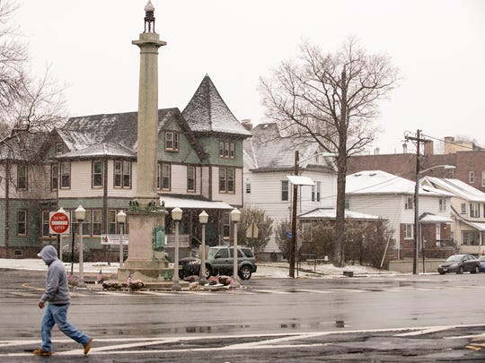 A man walks along Park Ave. in Rutherford during the