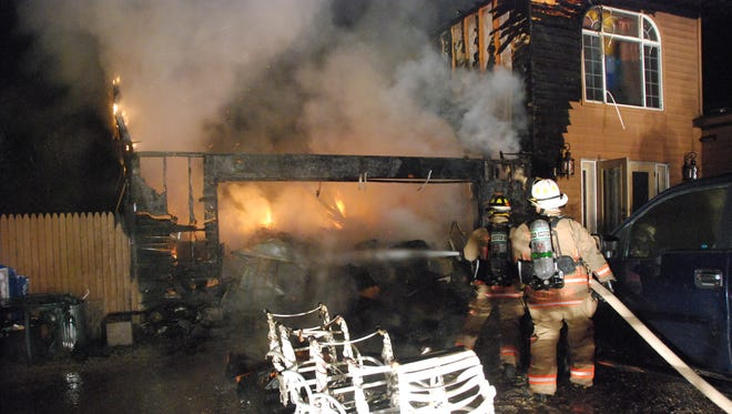 Door County firefighters spent several hours fighting a garage and house fire early Saturday morning.