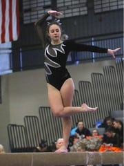 Plymouth senior Haley Metz shows why she won Division 1 balance beam and the all-around at Saturday's Region 3.
