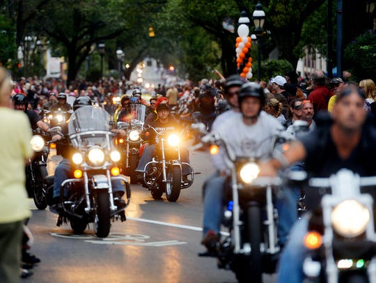 Bikers make their way down Market Street during the