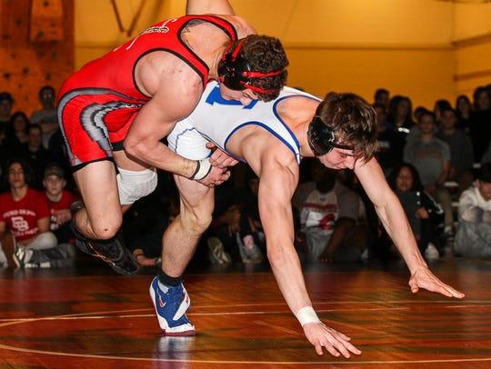 Bound Brook's Joe Casey, left, wrestles Holmdel's Scott
