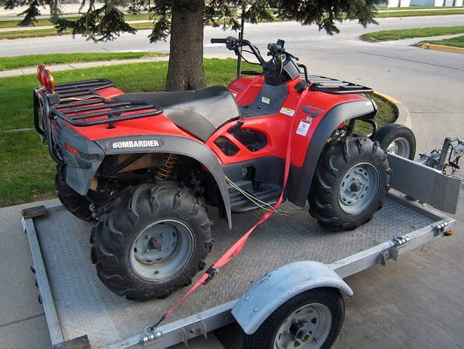 U.S. Army veteran Bruce Hadsall of Indianola owns this Can-Am ATV and trailer, which were stolen from his apartment complex Nov. 24. The ATV allowed Hadsall to hunt deer, despite severe nerve damage in his feet and lower legs.