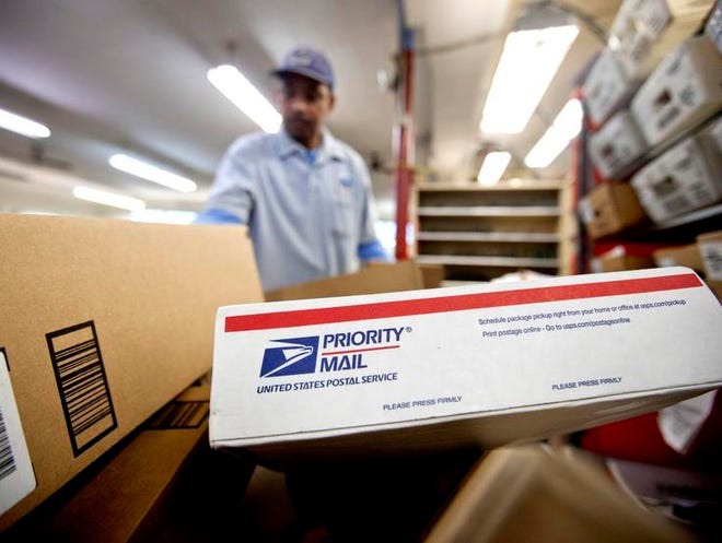 Packages wait to be sorted in an Atlanta Post Office. The U.S. Postal Service said Friday it lost $5 billion over the past year. It marks the agency's seventh straight annual loss, and postal officials urged Congress to pass legislation to help USPS solve its financial woes.
