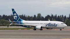 An Alaska Airlines Boeing 737 taxis for departure in