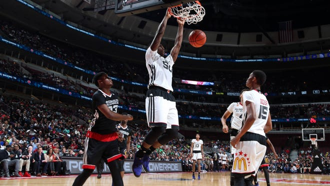 Caleb Swanigan (50), shown here dunking in the McDonald's All-American game, remains the subject of much recruiting speculation.