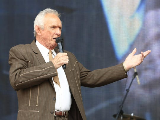 Mel Tillis performs at the Oklahoma Twister Relief Concert at the Gaylord Family-Oklahoma Memorial Stadium in Norman, Oklahoma, in 2013. Tillis, the longtime country star who wrote hits for Kenny Rogers, Ricky Skaggs and many others and overcame a stutter to sing on dozens of his own singles, has died.