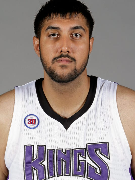 FILE - This Sept. 26, 2014 file photo shows Sacramento Kings rookie center Sim Bhullar, from New Mexico State, at the Kings media day in Sacramento, Calif. The Kings are signing Bhullar to a 10-day contract that will make him the league's first player of Indian descent, a person with knowledge of the deal said Wednesday, April 1, 2015. The person spoke to The Associated Press on condition of anonymity because the Kings are not expected to announce Bhullar's deal until Thursday.(AP Photo/Rich Pedroncelli, File)