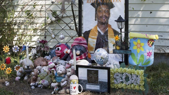 A memorial in front of a vacant home on Wallace Avenue where two men were killed in October 2014.