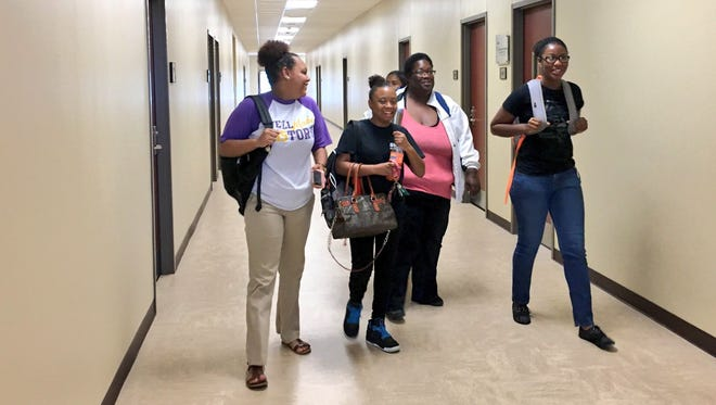 Students walk through the new Evangeline campus building of South Louisiana Community College in St. Martinville.