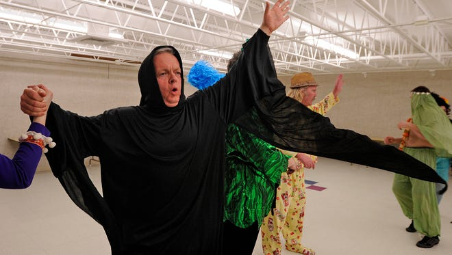 Two Rivers city manager Greg Buckley rehearses his role as the grim reaper for a past Heart-A-Rama show.