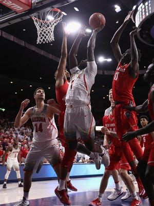 TUCSON, AZ - DECEMBER 20:  Rawle Alkins #1 of the Wildcats attempts a shot past Obij Aget #11 of the Lobos during the first half of the college basketball game at McKale Center on December 20, 2016 in Tucson, Arizona.
