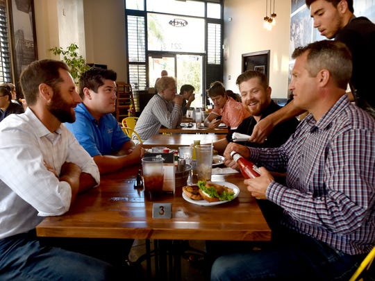 (From left) Griffin Berkley, Justin Veynay, Nathan Wollenman and Dan Harnish sit for lunch at Fresh & Fabulous Cafe in Oxnard.