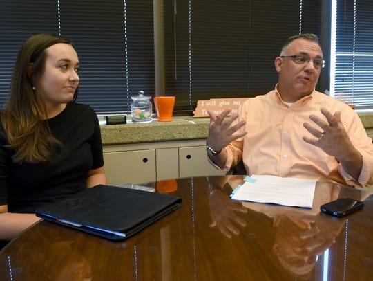 UTK Student Body President Morgan Hartgrove, left,