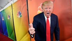 In this Jan. 16, 2015 file photo, Donald Trump, then-host