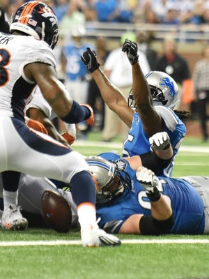 Lions running back Joique Bell puts his hands up after scoring a touchdown in the second quarter against the Broncos.