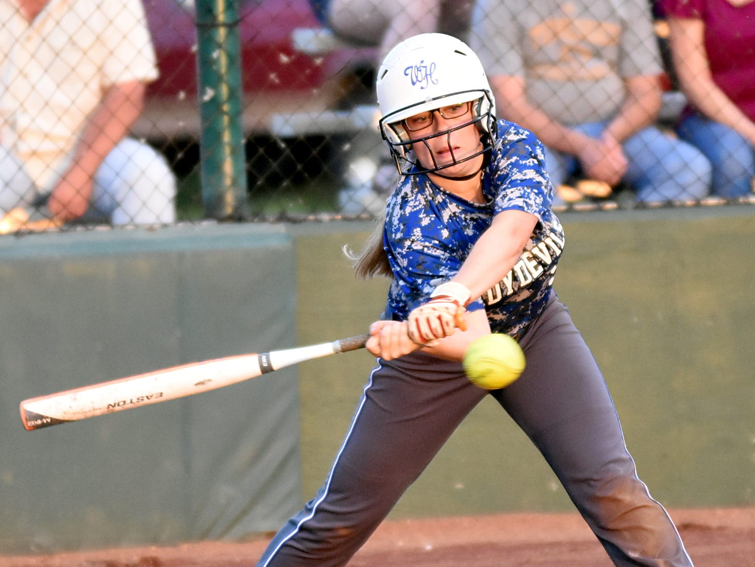 White House High sophomore Paige Vincent swings at a second-inning pitch during Wednesday evening's 6-2 loss to Greenbrier.