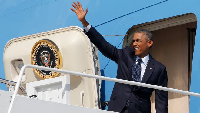 President Barack Obama boards Air Force One at Andrews Air Force Base for the NATO Summit in Estonia.