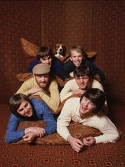 The Beach Boys, circa 1960s.  Clockwise from bottom left: Carl Wilson, Mike Love, Dennis Wilson, Al Jardine, Bruce Johnston, Brian Wilson.
