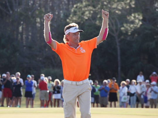 Bernhard Langer celebrates on the 18th hole green after