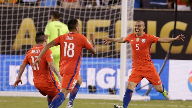 Jun 26, 2016: Chile midfielder Francisco Silva (5) celebrates after scoring on a penalty kick to defeat Argentina in the championship match of the 2016 Copa America Centenario soccer tournament at MetLife Stadium.