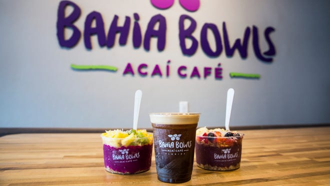 A Pitaya Bowl, Bahia Nitro coffee and Bahia Bowl at Bahia Bowls in Estero on Monday, Jan. 8, 2018. The new açaí cafe specializes in customizable smoothies and fruit bowls.