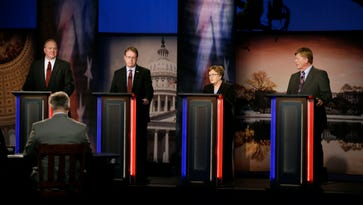 From left, Iowa Democratic candidates for U.S. Senate attorney Tom Fiegen, state Sen. Rob Hogg, former Lt. Gov. Patty Judge and former state legislator Bob Krause stand on stage during a debate Thursday, May 26, 2016, in Johnston.