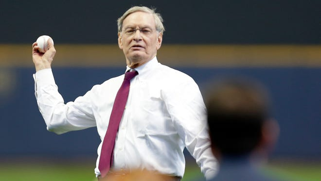 Bud Selig throws out the first pitch before a Brewers game against the Rockies at the Miller Park home opener on April 6, 2015.
