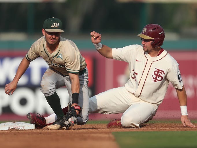 FSU's Cal Raleigh slides safely in to second base past